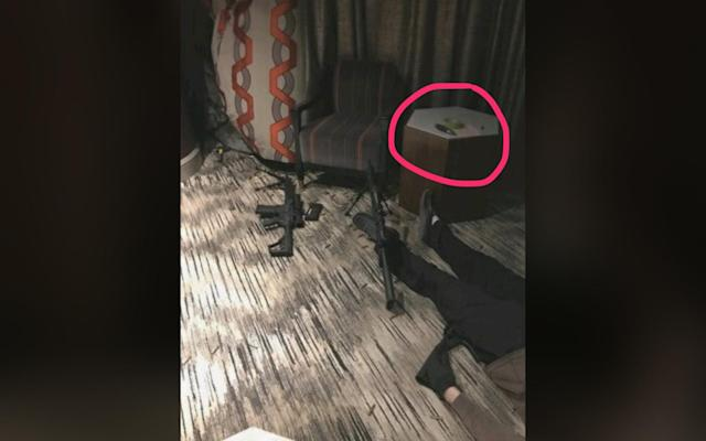 <p>Stephen Paddock's body is visible in his room at the Mandalay Hotel along with weapons he may have used during his mass shooting at the Route 91 Harvest country music festival in Las Vegas, Nev., on Oct 1, 2017. (Photo: Anonymous) </p>