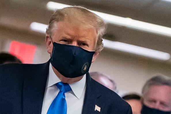 US President Donald Trump wears a mask as he visits Walter Reed National Military Medical Center in Bethesda, Maryland.