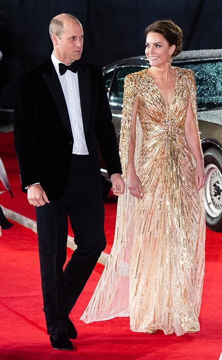 """Prince William and Kate Middleton at the premiere of 'No Time to Die.' Middleton's dress echoed one worn by William's late mother Princess Diana at the 1985 premiere of 'A View to a Kill.' <span class=""""copyright"""">Photo by Samir Hussein/WireImage</span>"""