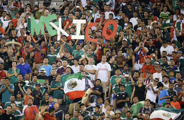 Fans cheer for Mexico during the second half of a CONCACAF Gold Cup soccer match against Costa Rica Sunday, July 19, 2015, at MetLife stadium in East Rutherford, N.J. (AP Photo/Mel Evans)