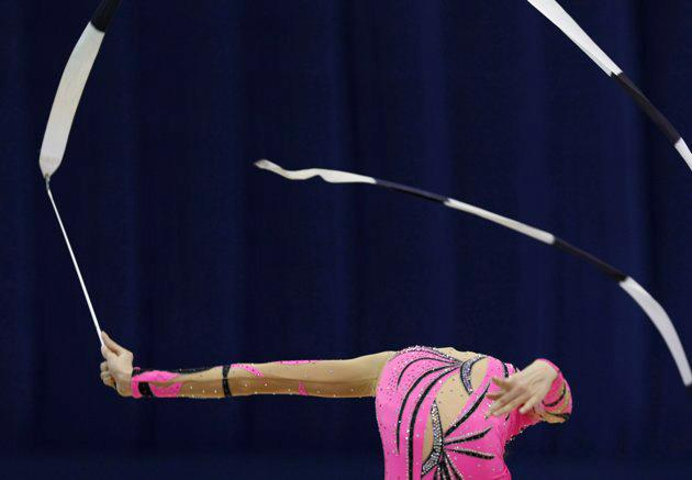 Vojislava Cekerevac of Serbia performs with the ribbon during the qualifying round of the Rhythmic Gymnastics World Championships in Ise, Mie prefecture, central Japan September 9, 2009. (REUTERS/Issei Kato)