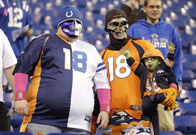 Fans dress for Halloween before an NFL football game between the Indianapolis Colts and the Denver Broncos, Sunday, Oct. 20, 2013, in Indianapolis. (AP Photo/Michael Conroy)