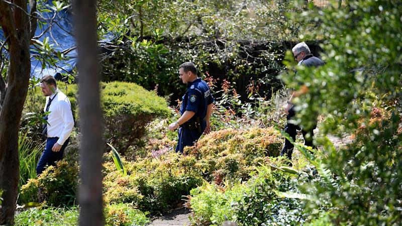 NSW Police and Forensic Services personnel are seen moving through Ms Dawson's home in September this year. Image: AAP