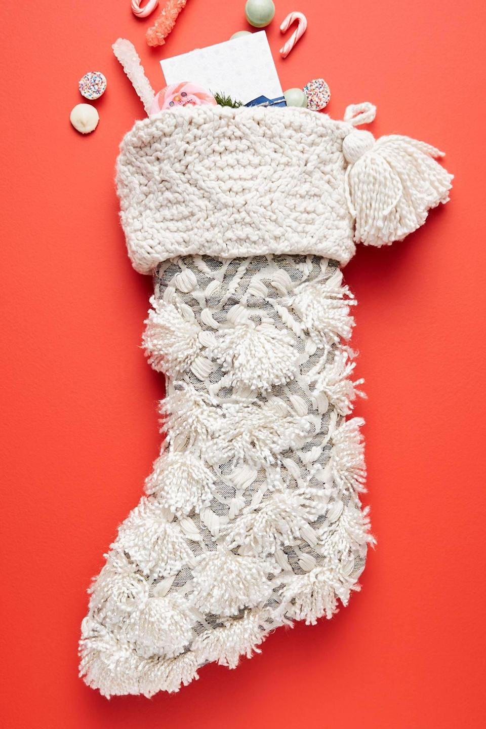 """<p>Incorporate fun texture into your holiday decor with the <a href=""""https://www.popsugar.com/buy/Sugar-Plum-Stocking-490450?p_name=Sugar%20Plum%20Stocking&retailer=anthropologie.com&pid=490450&price=48&evar1=casa%3Aus&evar9=46615300&evar98=https%3A%2F%2Fwww.popsugar.com%2Fhome%2Fphoto-gallery%2F46615300%2Fimage%2F46615320%2FSugar-Plum-Stocking&list1=shopping%2Canthropologie%2Choliday%2Cchristmas%2Cchristmas%20decorations%2Choliday%20decor%2Chome%20shopping&prop13=mobile&pdata=1"""" rel=""""nofollow noopener"""" class=""""link rapid-noclick-resp"""" target=""""_blank"""" data-ylk=""""slk:Sugar Plum Stocking"""">Sugar Plum Stocking</a> ($48).</p>"""