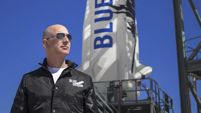 Blue Origin's New Shepard rocket, seen here with company owner Jeff Bezos, will boost passengers on sub-orbital trips above the internationally recognized 62-mile-high   - e28879aa698b99bbb7afa19b59303f66 - Richard Branson heading for space this weekend