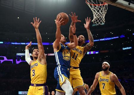 FILE PHOTO: Jan 21, 2019; Los Angeles, CA, USA; Golden State Warriors guard Stephen Curry (30) shoots the ball against Los Angeles Lakers guard Josh Hart (3) and Los Angeles Lakers forward Michael Beasley (11) during the first quarter at Staples Center. Mandatory Credit: Richard Mackson-USA TODAY Sports - 12036317/File Photo