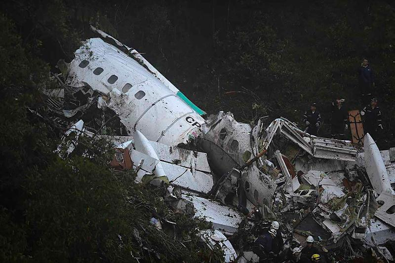 The wreckage of the LAMIA airlines charter plane carrying members of the Chapecoense Real football team is seen after it crashed in the mountains of Cerro Gordo, municipality of La Union, on November 29, 2016. A charter plane carrying the Brazilian football team crashed in the mountains in Colombia late Monday, killing as many as 75 people, officials said. / AFP / Raul ARBOLEDA (Photo credit should read RAUL ARBOLEDA/AFP via Getty Images)