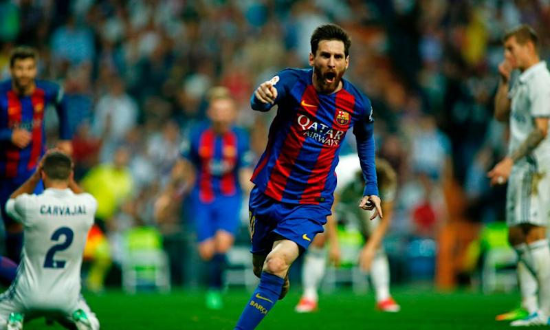 Lionel Messi celebrates scoring Barcelona's winner, his second goal of the night, in added time at Real Madrid.