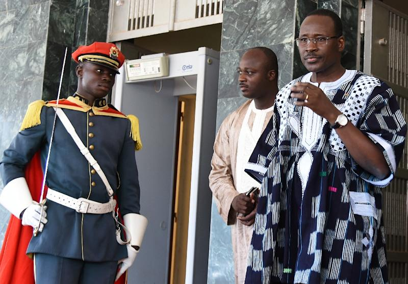 Burkina Faso's prime minister Isaac Zida (R) leaves the country's first post-coup cabinet meeting, September 25, 2015 in Ouagadougou (AFP Photo/Sia Kambou)