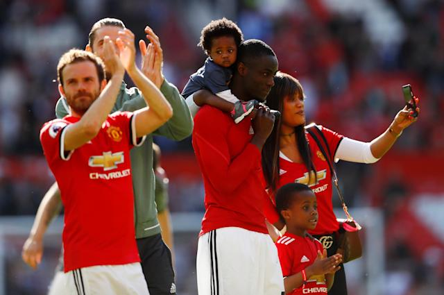 "Soccer Football - Premier League - Manchester United vs Watford - Old Trafford, Manchester, Britain - May 13, 2018 Manchester United's Eric Bailly with his family after the match and Juan Mata with David De Gea Action Images via Reuters/Jason Cairnduff EDITORIAL USE ONLY. No use with unauthorized audio, video, data, fixture lists, club/league logos or ""live"" services. Online in-match use limited to 75 images, no video emulation. No use in betting, games or single club/league/player publications. Please contact your account representative for further details."