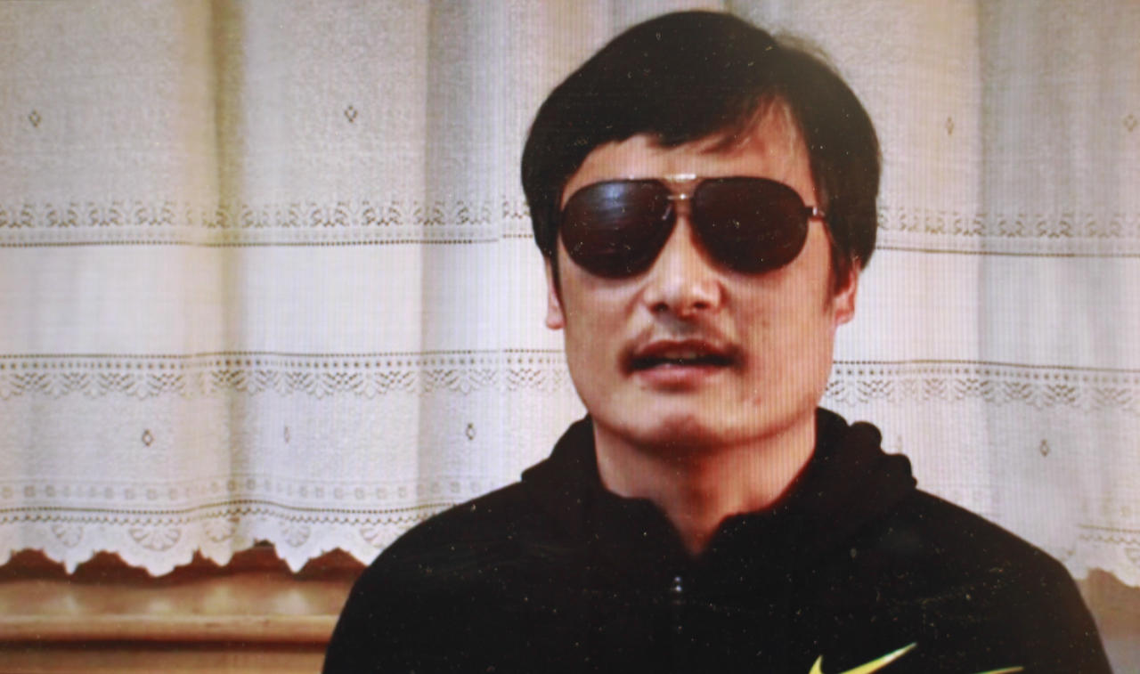 "In this image made from video, blind legal activist Chen Guangcheng is seen on a video posted to YouTube Friday, April 27, 2012 by overseas Chinese news site Boxun.com. ""I am now free. But my worries have not ended yet,"" Chen said in the video that was recorded this week and that activists sent Friday to Boxun.com. Speaking to a camera in a room with an off-white curtain drawn behind him, Chen said, ""My escape might ignite a violent revenge against my family."" (AP Photo/Boxun.com)"