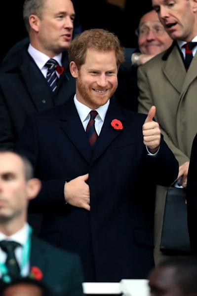 Britain's Prince Harry smiles in the stands during the Autumn International match between England and South Africa at Twickenham Stadium, London, Saturday, Nov. 12, 2016. (Mike Egerton/PA via AP)