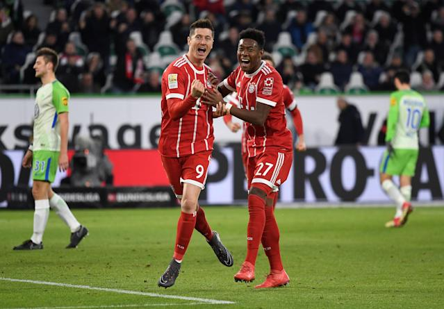 Soccer Football - Bundesliga - VfL Wolfsburg vs Bayern Munich - Volkswagen Arena, Wolfsburg, Germany - February 17, 2018 Bayern Munich's Robert Lewandowski celebrates scoring their second goal with David Alaba REUTERS/Fabian Bimmer DFL RULES TO LIMIT THE ONLINE USAGE DURING MATCH TIME TO 15 PICTURES PER GAME. IMAGE SEQUENCES TO SIMULATE VIDEO IS NOT ALLOWED AT ANY TIME. FOR FURTHER QUERIES PLEASE CONTACT DFL DIRECTLY AT + 49 69 650050