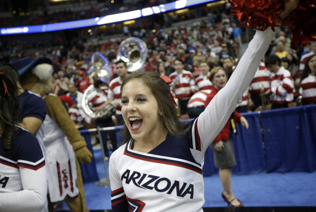 An Arizona cheerleader performs prior to a regional semifinal NCAA college basketball tournament game against San Diego State, Thursday, March 27, 2014, in Anaheim, Calif. (AP Photo/Jae C. Hong)