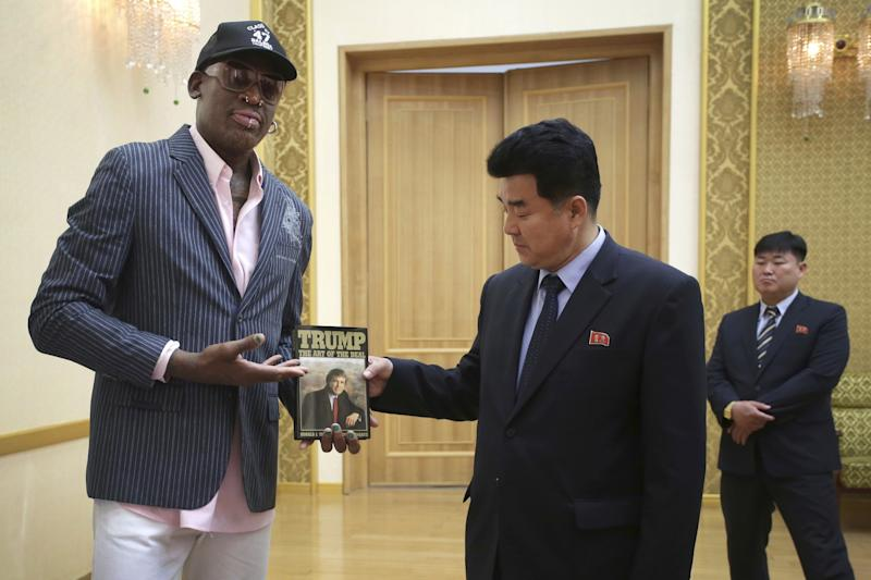 Former NBA basketball star Dennis Rodman presents a book titled