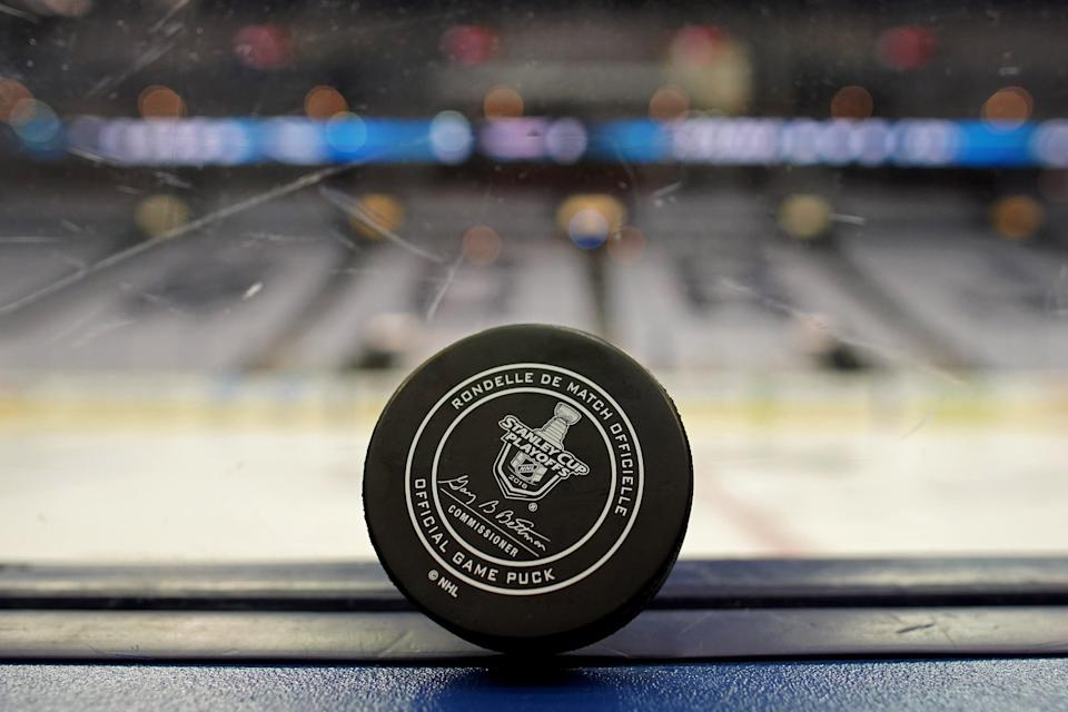 A view of an official game puck with the Stanley Cup logo