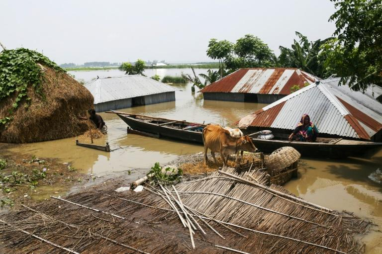 Bangladesh has been particularly hard hit by the monsoon, with about a third of the country now under water (AFP Photo/REHMAN ASAD)