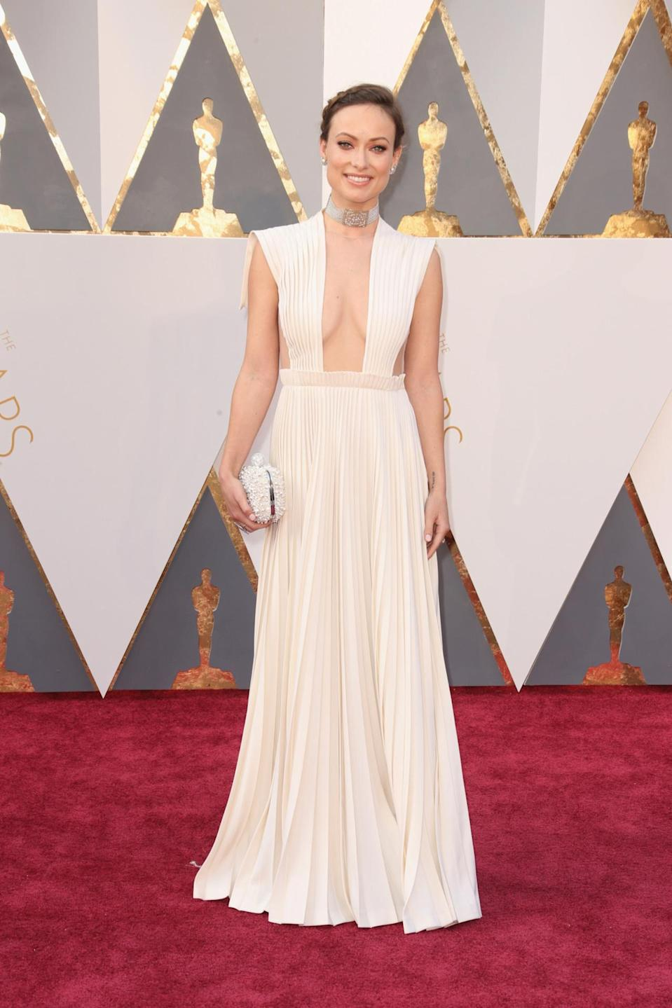 <p>Side boob and cleavage — talk about revealing! Olivia Wilde went, well, wild in a white Valentino Haute Couture gown. <i><i>(Photo: Getty Images)</i></i></p>