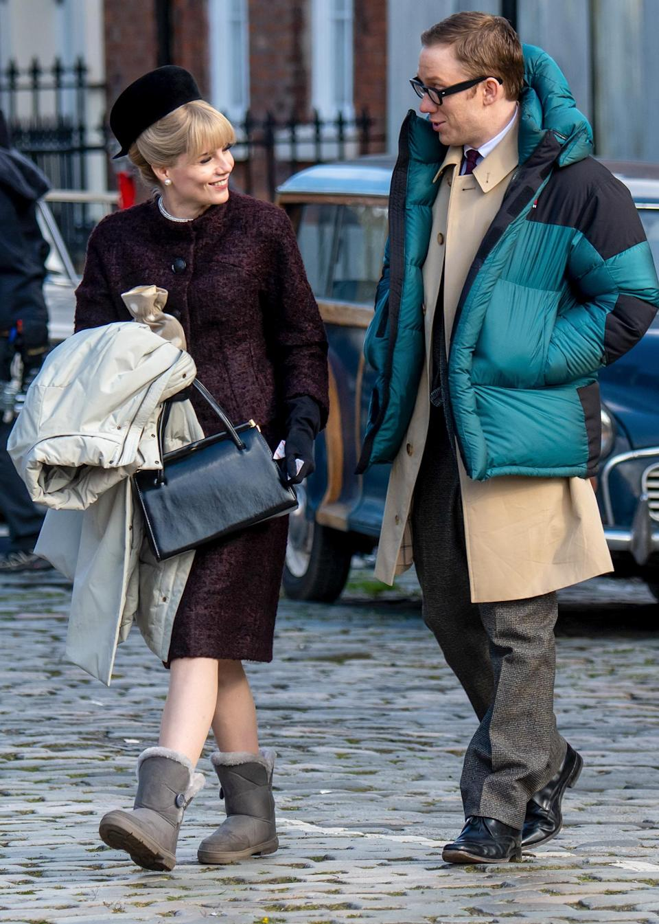 <p>Lucy Boynton and costar Joe Cole chat in between filming scenes for <em>The Ipcress File</em> on Tuesday in Liverpool.</p>
