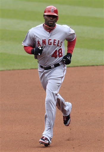 Los Angeles Angels' Torii Hunter runs the bases after hitting a solo home run off Cleveland Indians' Jeanmar Gomez in the fourth inning in a baseball game, Saturday, April 28, 2012, in Cleveland. (AP Photo/Tony Dejak)