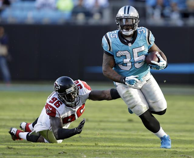 Carolina Panthers' Mike Tolbert (35) runs past Atlanta Falcons' Jonathan Massaquoi (96) in the second half of an NFL football game in Charlotte, N.C., Sunday, Nov. 3, 2013. The Panthers won 34-10. (AP Photo/Bob Leverone)