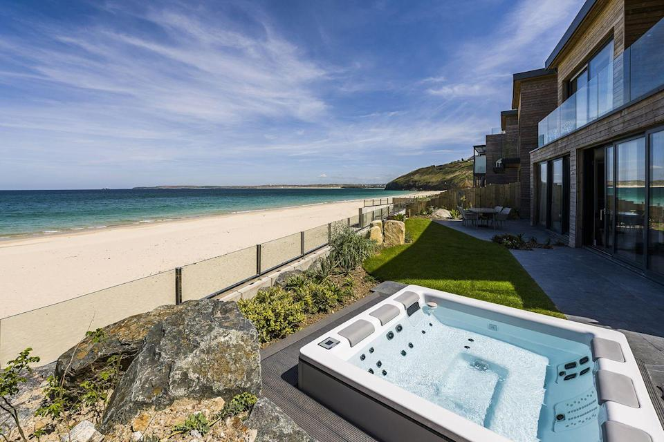 """<p>Who needs the Maldives when we have the seaside village of Carbis Bay? Set within 125-acres and part of the 125 acres that makes up Carbis Bay Estate, the luxurious <a href=""""https://go.redirectingat.com?id=127X1599956&url=https%3A%2F%2Fwww.booking.com%2Fhotel%2Fgb%2Fcarbis-bay-hotel.en-gb.html%3Faid%3D2070929%26label%3Dsynd-cornwall-hotels&sref=https%3A%2F%2Fwww.redonline.co.uk%2Ftravel%2Finspiration%2Fg35836742%2Fbest-hotels-in-cornwall-1%2F"""" rel=""""nofollow noopener"""" target=""""_blank"""" data-ylk=""""slk:Carbis Bay Hotel"""" class=""""link rapid-noclick-resp"""">Carbis Bay Hotel</a> is set against the glorious backdrop of its own 25-acre Blue Flag beach. Apart from its excellent location, at one of the best hotels in Cornwall, you'll find the C Bay Spa offering coastal-inspired treatments, a Sunseeker yacht for private excursions and fine dining at The Sands Restaurant. </p><p>You must experience the Beach Club, an alluring lounge and outdoor terrace where you can take in panoramic views of the ocean while enjoying Mediterranean food. At the Carbis Bay Hotel, the facilities are set within sub-tropical gardens and there's access to the South West Coast Path, which connects Carbis Bay to St Ives in under 25 minutes by foot. If you're after a Cornish hotel you'll never forget, this is a place worth knowing about.</p><p><a class=""""link rapid-noclick-resp"""" href=""""https://go.redirectingat.com?id=127X1599956&url=https%3A%2F%2Fwww.booking.com%2Fhotel%2Fgb%2Fcarbis-bay-hotel.en-gb.html%3Faid%3D2070929%26label%3Dsynd-cornwall-hotels&sref=https%3A%2F%2Fwww.redonline.co.uk%2Ftravel%2Finspiration%2Fg35836742%2Fbest-hotels-in-cornwall-1%2F"""" rel=""""nofollow noopener"""" target=""""_blank"""" data-ylk=""""slk:CHECK AVAILABILITY"""">CHECK AVAILABILITY</a></p>"""
