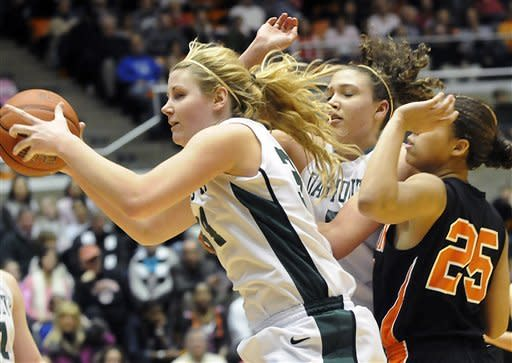 Dartmouth's Sasha Dosenko, left, pulls down a rebound in front of Tia Dawson, center, and Princeton's Mariah Smith (25) during an NCAA college basketball game, Saturday, Feb. 25, 2012, in Princeton, N.J. Princeton won 94-57. (AP Photo/MJ Schear)