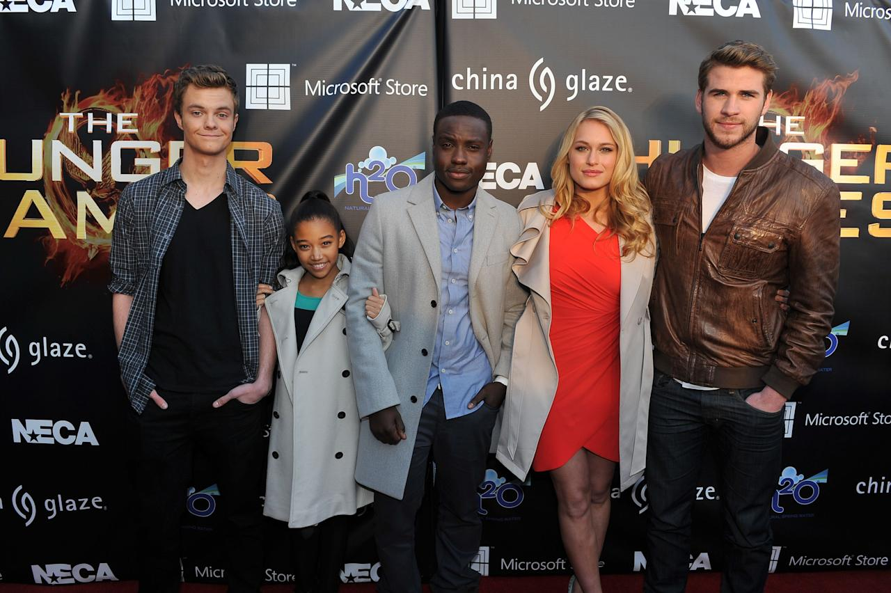 """ATLANTA, GA - MARCH 06: (L-R) Actor Jack Quaid, actress Amandla Stenberg, actor Dayo Okeniyi, actress Leven Rambin actor and Liam Hemsworth attend """"The Hunger Games"""" National Mall tour fan event at Lenox Square on March 6, 2012 in Atlanta, Georgia. (Photo by Moses Robinson/Getty Images)"""
