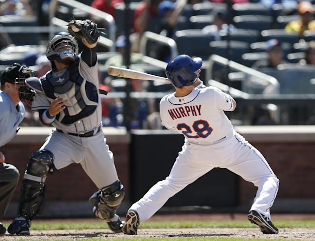 New York Mets' Daniel Murphy (28) ducks San Diego Padres relief pitcher Alex Torres' high pitch into Rene Rivera's mitt during the sixth inning of a baseball game in New York, Sunday, June 15, 2014. (AP Photo/Kathy Willens)