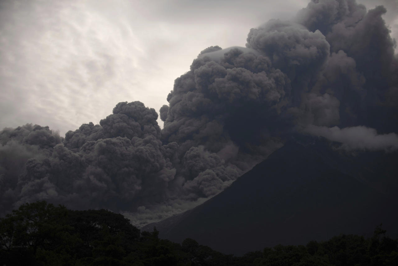 <p>Volcan de Fuego, or Volcano of Fire, blows outs a thick cloud of ash, as seen from Alotenango, Guatemala on Sunday. (AP) </p>