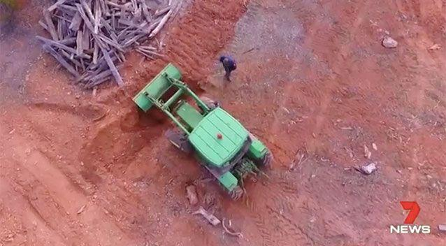 Excavators dig in an area of interest. Source: 7 News