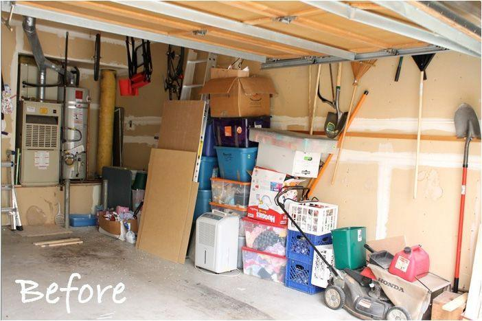 """<p>Crates full of clothes, a lawn mower, and random cardboard boxes line the wall of <a href=""""http://www.thekimsixfix.com/p/before-and-after.html"""" rel=""""nofollow noopener"""" target=""""_blank"""" data-ylk=""""slk:a garage"""" class=""""link rapid-noclick-resp"""">a garage</a>, making it look junky and disorganized. </p>"""