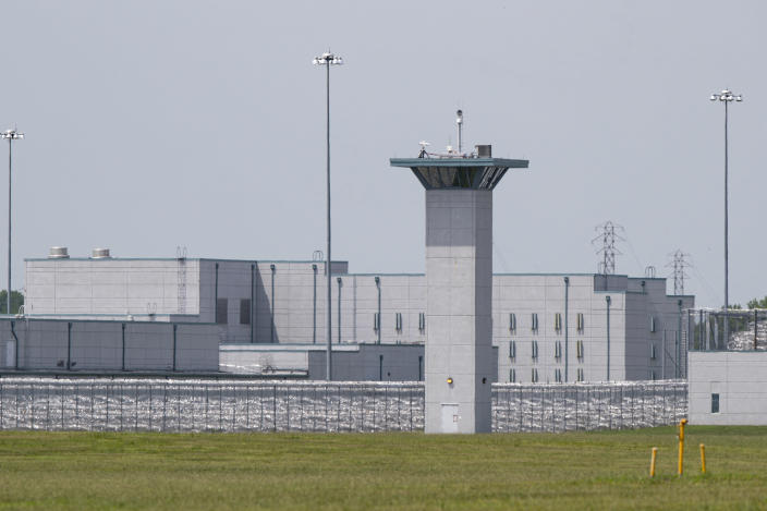The entrance to the federal prison in Terre Haute, Ind., is seen Wednesday, July 15, 2020. (AP Photo/Michael Conroy)
