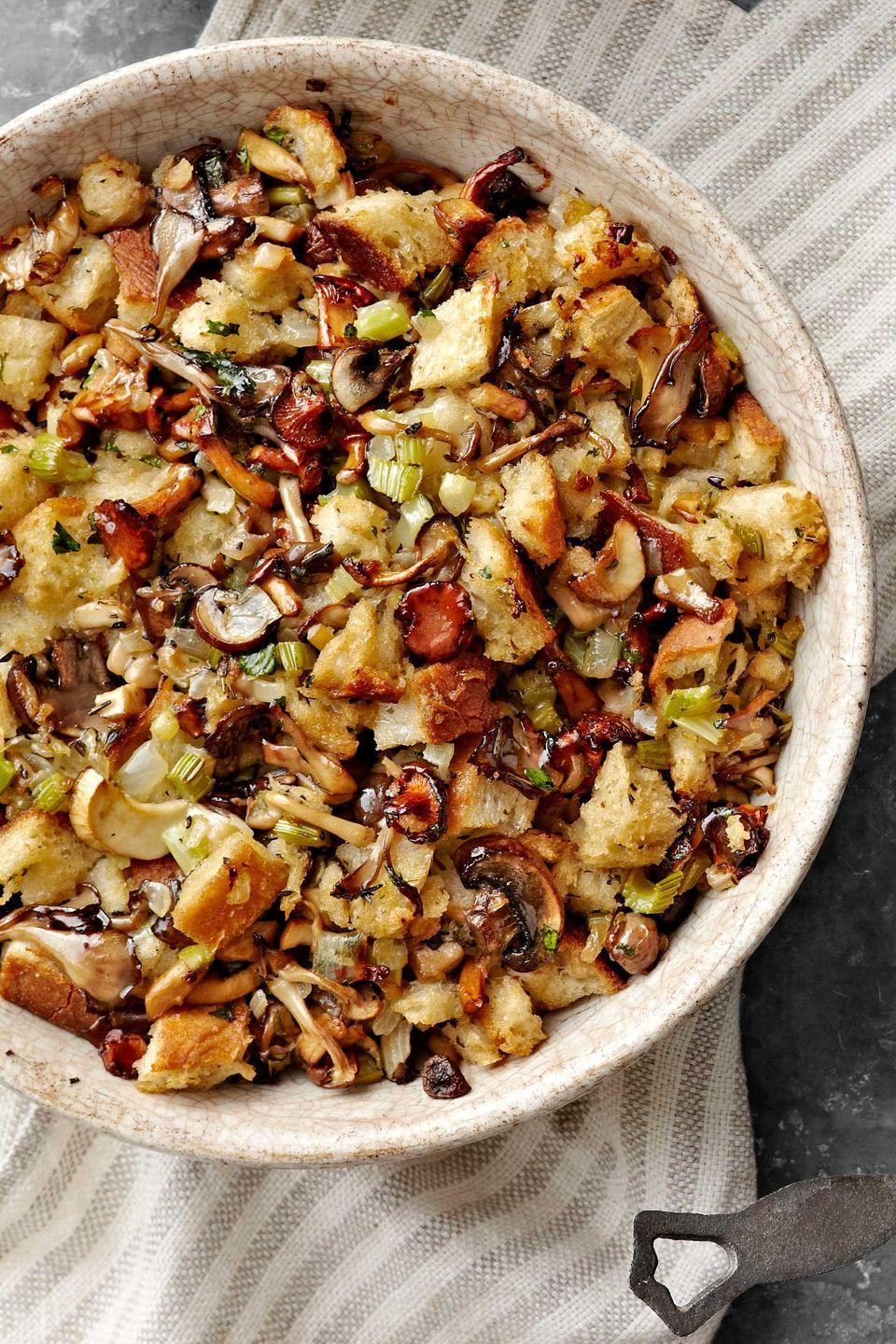 "<p class=""imageContent"">A lighter-than-expected stuffing. Serve this Thanksgiving favorite with <a href=""https://www.countryliving.com/food-drinks/recipes/a4237/perfect-roast-turkey-recipe-clv1112/"" rel=""nofollow noopener"" target=""_blank"" data-ylk=""slk:The Perfect Roast Turkey"" class=""link rapid-noclick-resp""><strong>The Perfect Roast Turkey</strong></a>. Assemble the stuffing a day ahead in a buttered dish, cover, refrigerate, and bake when needed.</p><p class=""imageContent""><strong><a href=""https://www.countryliving.com/food-drinks/recipes/a1135/sourdough-mushroom-stuffing-3242/"" rel=""nofollow noopener"" target=""_blank"" data-ylk=""slk:Get the recipe"" class=""link rapid-noclick-resp"">Get the recipe</a>.</strong><br></p>"