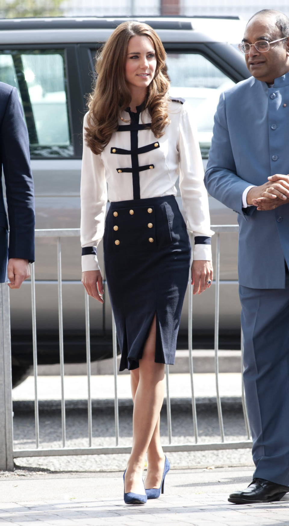 <p>Kate visited a community centre wearing a military ensemble by Alexander McQueen. She paired the silk shirt and slitted skirt with trusty navy pumps. </p><p><i>[Photo: PA]</i></p>