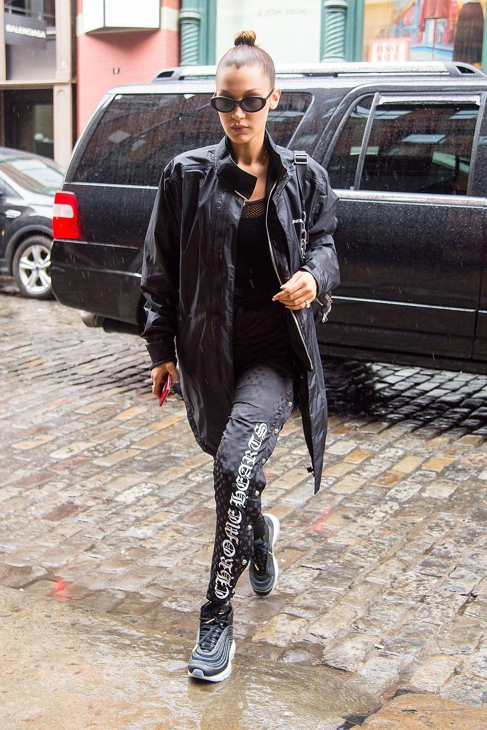"""<p>In a sleek raincoat, <span class=""""redactor-unlink"""">Chrome Hearts x Bella</span> silk sweats and sneakers out in Manhattan. </p>"""