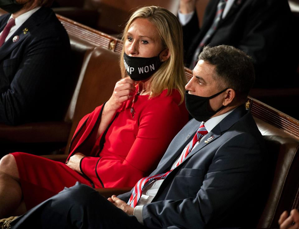 Georgia Republican Congresswoman Marjorie Taylor Greene on the House floor wearing a mask that isn't covering her nose. (Getty Images)