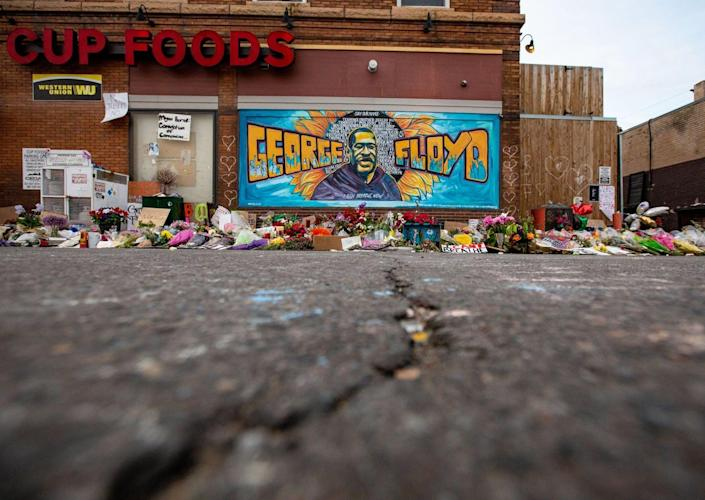 """<span class=""""caption"""">Minneapolis, a city still split along racial lines.</span> <span class=""""attribution""""><a class=""""link rapid-noclick-resp"""" href=""""https://www.gettyimages.com/detail/news-photo/the-mural-and-makeshift-memorial-outside-cup-foods-where-news-photo/1216644310?adppopup=true"""" rel=""""nofollow noopener"""" target=""""_blank"""" data-ylk=""""slk:Jason Armond/Los Angeles Times via Getty Images"""">Jason Armond/Los Angeles Times via Getty Images</a></span>"""