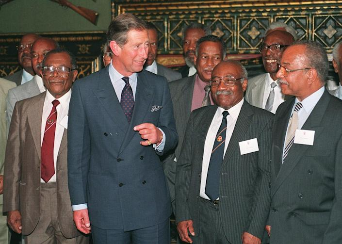 LONDON, UNITED KINGDOM - JUNE 25:  Britain's Prince Charles talks with some of the original settlers from the Caribbean, 25 June, when he hosted, at James Palace, a reception to mark the 50th anniversary of the arrival in the UK of the SS Empire Windrush. The Windrush brought the first Caribbean settlers to Britain. The Prince met some of those who made the pioneering voyage in answer to the call for labour after the Second World War.  (Photo credit should read JOHNNY EGGITT/AFP via Getty Images)