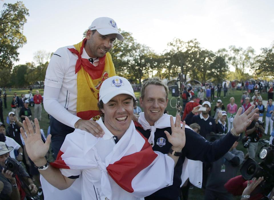 Europe's Sergio Garcia, Rory McIlroy and Luke Donald celebrate after winning the Ryder Cup PGA golf tournament Sunday, Sept. 30, 2012, at the Medinah Country Club in Medinah, Ill. (AP Photo/Charlie Riedel)