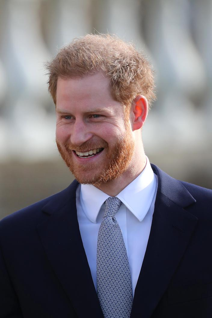 Prince Harry, Duke of Sussex, smiles as he arrives to host the Rugby League World Cup 2021 draws at Buckingham Palace today. [Photo: Getty]