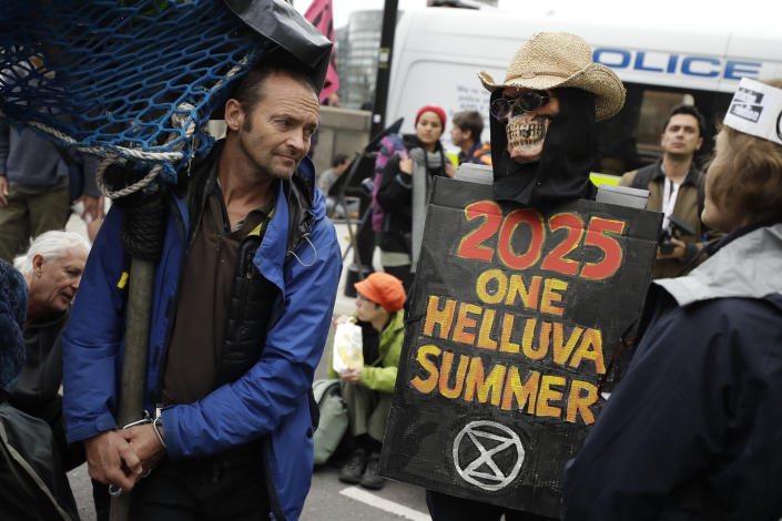 Climate protestors block Millbank in central London Monday, Oct. 7, 2019. (Photo: Matt Dunham/AP)