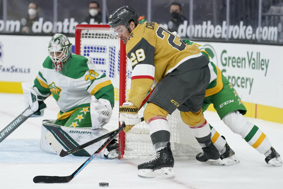 Vegas Golden Knights left wing William Carrier (28) looks to shoot against Minnesota Wild goaltender Cam Talbot (33) during the second period of an NHL hockey game Wednesday, March 3, 2021, in Las Vegas. (AP Photo/John Locher)