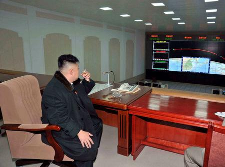 FILE PHOTO: North Korean leader Kim Jong-Un smokes a cigarette at the General Satellite Control and Command Center after the launch of the Unha-3 (Milky Way 3) rocket carrying the second version of Kwangmyongsong-3 satellite at West Sea Satellite Launch Site in Cholsan county, North Pyongan province December 12, 2012, in this picture released by the North's KCNA news agency in Pyongyang December 13, 2012.   KCNA/via REUTERS/File Picture
