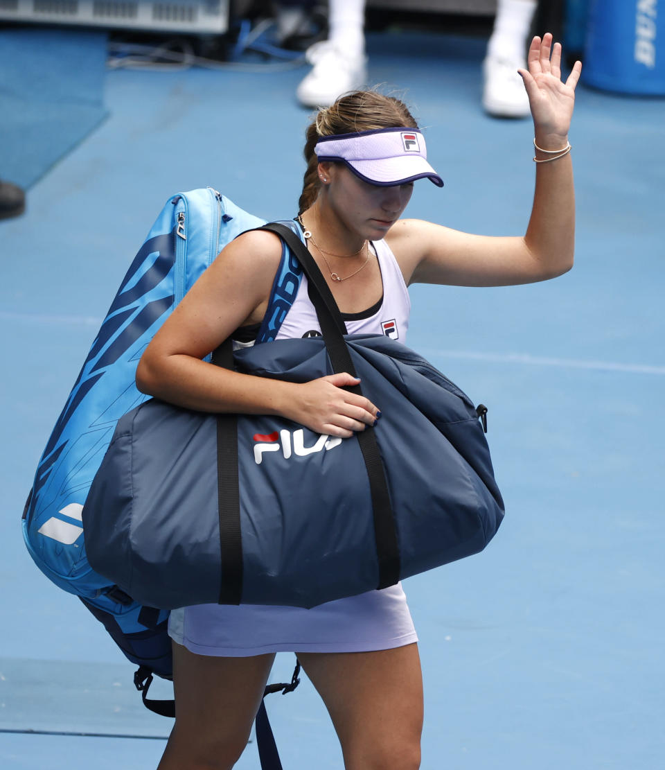 United States' Sofia Kenin waves as she leaves the court following her second round loss to Estonia's Kaia Kanepi during at the Australian Open tennis championship in Melbourne, Australia, Thursday, Feb. 11, 2021.(AP Photo/Rick Rycroft)