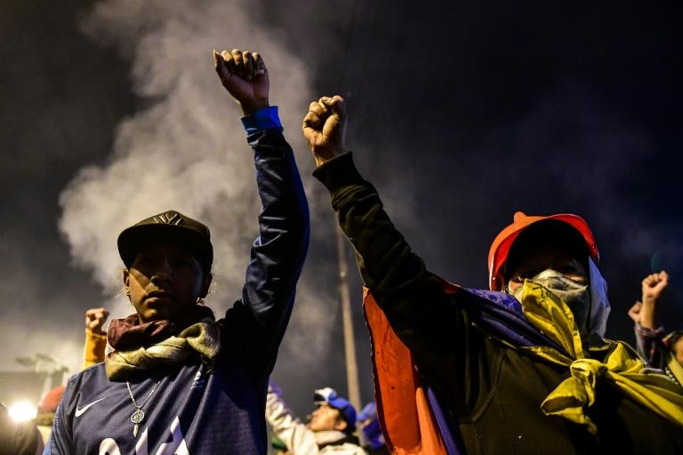 Thousands flooded into the streets of Quito to celebrate shortly after the deal was announced (AFP Photo/Martin BERNETTI)