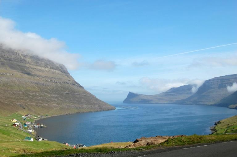 The Faroes is a popular tourist destination for its fascinating landscapes with 30-metre cliffs (AFP Photo/Pierre-Henry DESHAYES)