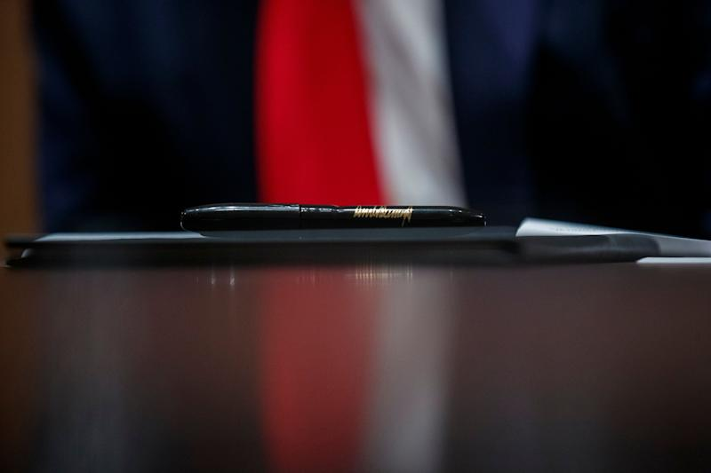 A pen to be used by President Donald Trump rests upon an executive order during a meeting with U.S. tech workers Monday at the White House. Trump later signed the order to prioritize hiring American workers during the economic crisis. (Photo: Alex Brandon/ASSOCIATED PRESS)