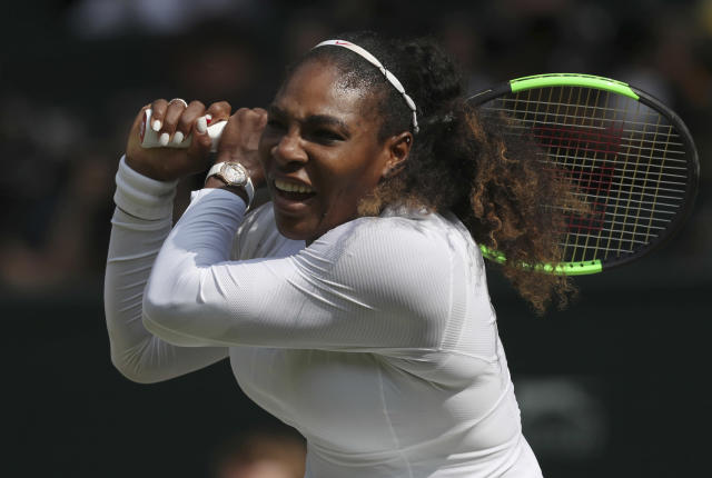 Serena Williams of the US returns to Julia Goerges of Germany in their women's semifinal match at the Wimbledon Tennis Championships in London, Thursday July 12, 2018. (Jonathan Brady/Pool via AP)