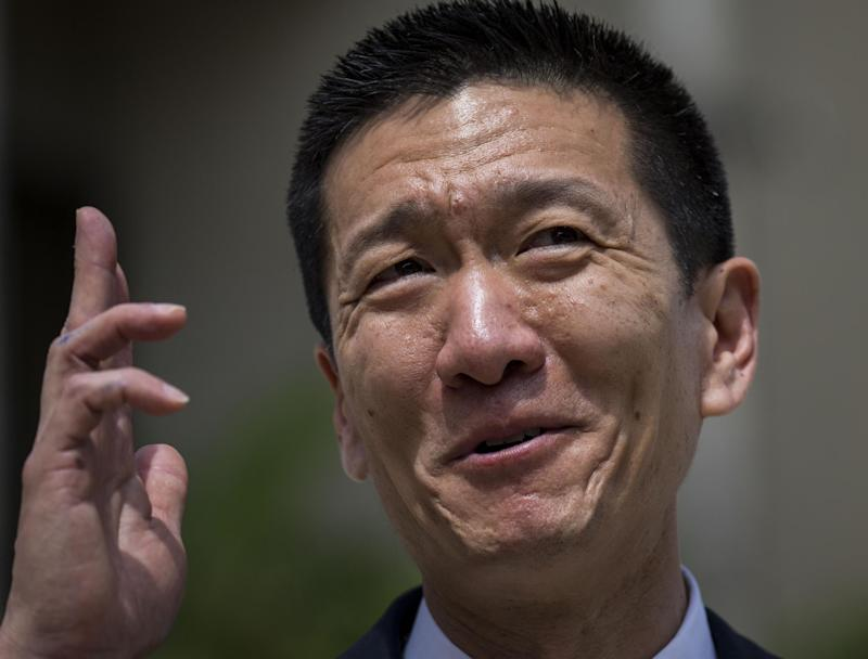 Hawaii State Attorney General Douglas Chin speaks at a press conference in Honolulu: AFP/Getty Images